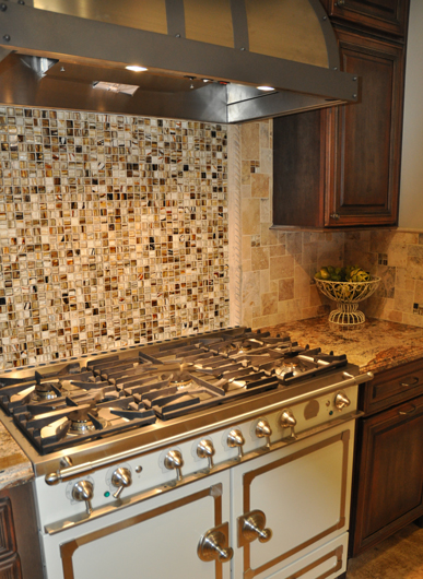 In This Backsplash Glass Tile Is Used As A Feature Panel Behind The Stove.  It Is Also Used As An Accent In The Natural Stone Field Tile That Makes Up  The ...